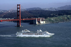 Cruise Ship. Golden Gate Bridge in San Francisco  and large modern cruise ship Stock Images