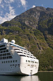 Cruise ship. A cruise ship in a beautiful fjord. Geirangerfjord, Norwey Stock Image