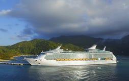 Cruise ship. Against Caribbean mountains Stock Photos
