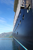 Cruise ship. Blue cruise ship in a Norwegian fjord Stock Images