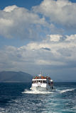 Cruise ship with passengers on the sea Stock Photo