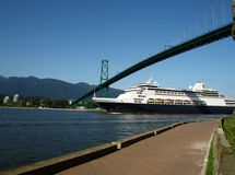 Cruise ship. Luxurious cruise ship passing under lions gate bridge in Vancouver stock image
