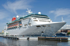 Cruise ship. White cruise ship on a mooring royalty free stock photo