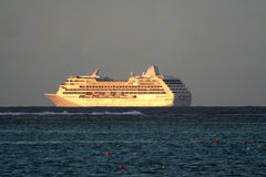 Cruise ship. On a stormly sky, at sunset Royalty Free Stock Photos