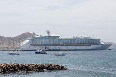 Cruise Ship Across Bay on St Kitts. A luxury cruise ship anchored in the bay on St Kitts Stock Photo