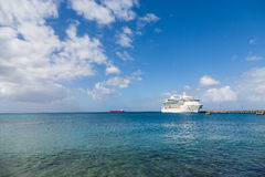 Cruise Ship Across Calm Blue Bay. White Luxury Cruise Ship Docked at St Croix Stock Photo