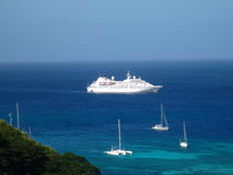 Cruise ship in Admiralty Bay, Bequia. A cruise ship anchored at admiralty bay with sailing yachts in the foreground Stock Photo