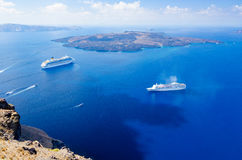 Cruise ship on Aegean sea, Cyclades, Greece. View on beautiful greek island Cyclades Royalty Free Stock Photography
