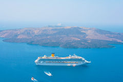 Cruise Ship Against Volcanic Island In Santorini Stock Image