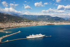 Cruise ship in Alanya harbor Stock Images