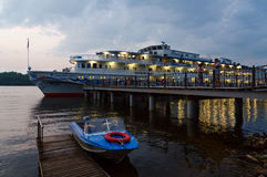 Cruise ship Alexandre Benois at river quay in evening, Russia Stock Photo