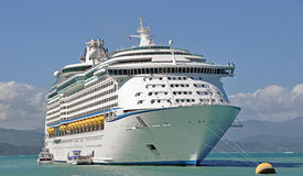 Cruise ship anchored. A cruise ship anchored in the Dominican Republic with tenders docked to it Stock Images