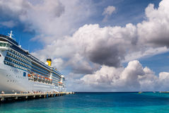 Cruise ship anchored in a caribbean port Stock Photography