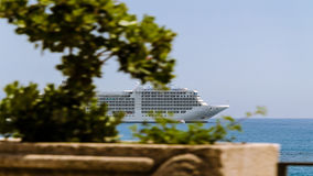 Cruise ship anchored. Off the Bay of Taormina Italy Stock Images
