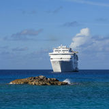 Cruise ship anchored off coast Royalty Free Stock Images