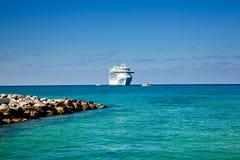 Cruise Ship Anchored on Tropical Island Stock Photos