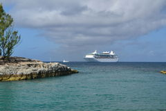Cruise ship. Anchored of a tropical island Royalty Free Stock Photos