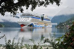 Cruise ship anchored in Ulwik fjord Royalty Free Stock Photography