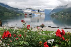 Cruise ship anchored in Ulwik fjord. Ulwik, Norway: Cruise ship AIDA luna anchored in Ulwik fjord on Augustus 18, 2010 Stock Images