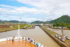 Cruise ship Approaching Locks at Panama Canal, Panama. Unrecognizable People. Cloudy Sky royalty free stock photos