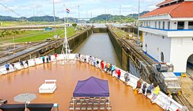 Cruise ship Approaching Locks at Panama Canal, Panama. Unrecognizable People. Cloudy Sky royalty free stock photo