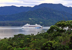 Cruise ship arriving at Ilhabela via Sao Sebatiao channel Royalty Free Stock Image