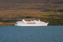 Cruise ship arriving to Akureyri port in Iceland. On a summer day Royalty Free Stock Image
