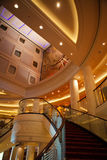 Cruise Ship Atrium. The central atrium and staircase on the QM Stock Photo