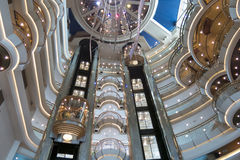 Cruise ship Atrium. Multiple level atrium on a passenger cruise ship showing several elevators stock photography