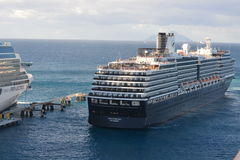 Cruise ship backing into port Stock Image