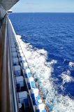 Cruise ship balconies. View from above, looking down on cruise ship balconies and the blue ocean flowing by below Stock Image