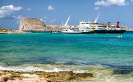 Cruise ship in Balos, Crete - Greece. BALOS, CRETE - JULY 21:  A lot of people in frot of cruise ship at lagoon Balos in Greece on September 21, 2017 in Balos Stock Photos