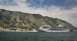 Cruise ship in the bay against the backdrop of the mountains stock photos