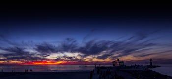 Cruise ship beach take off sky nightfall Warnemünde Stock Images