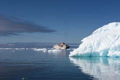 Cruise ship behind Iceberg Greenland Stock Images