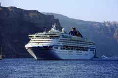 Free Cruise Ship Below The Cliff Of Fira Stock Photography - 124055632