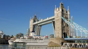 The cruise ship Berlin passes under Tower Bridge. 4X Speed. The cruise ship Berlin passes under Tower Bridge on a bright sunny day. Footage is speeded up to 4X stock video footage