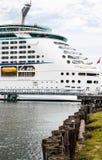 Cruise Ship Beyond Row of Pilings Stock Photo
