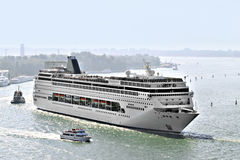 Cruise ship. Big cruise ship on water surrounded by boats Royalty Free Stock Photography