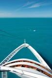 Cruise ship bow on the high seas. White cruise ship bow on the high seas with clear turquoise water Royalty Free Stock Photo