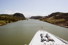 Cruise ship bow  passing Panama Canal  (the bridge on the front far). Stock Image