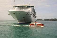 CRUISE SHIP BOW AND SHIP TENDER Stock Photos