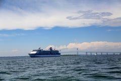 Cruise Ship by Bridge in Choppy Sea. Blue and white cruise ship docked by bridge in Newport Rhode Island Stock Photography