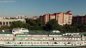 A cruise ship. The bridge over the highway bridge across the Volga, Swan Lake. Volga. Beautiful multi-storey houses near the river stock footage