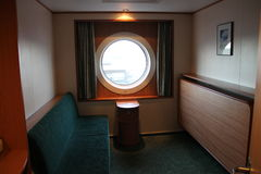 Cruise ship cabin. The view from the cabin through the porthole of the tourist ferries, ships, cruise, travel, Europe, sea, sky, water, glass, boat, excursion Royalty Free Stock Photography