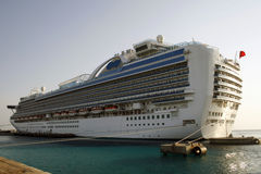 Cruise ship in Caribbean. Big cruise ship docking at port in Caribbean Royalty Free Stock Image