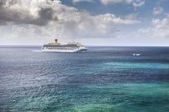 Cruise ship in Caribbean sea. Cruise ship on the horizon of Caribbean sea Stock Photos