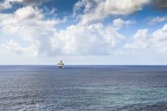 Cruise ship in Caribbean sea. Cruise ship on the horizon of Caribbean sea Royalty Free Stock Photos