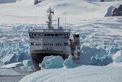 A Cruise Ship Among Chunks of Ice in Antarctica stock photos