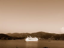 Cruise ship and coastline. Scenic sepia view of white cruise ship with caribbean coastline in background Royalty Free Stock Photo